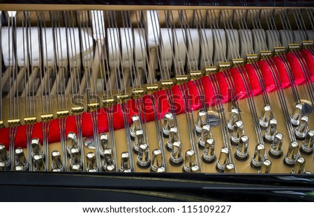 detail of a piano string - stock photo