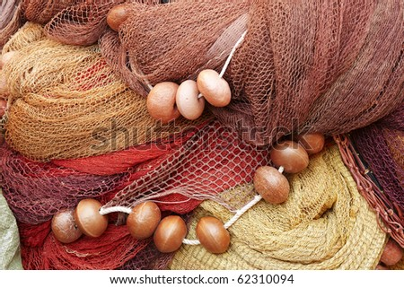 Detail of a pile of fishing nets with floats - stock photo