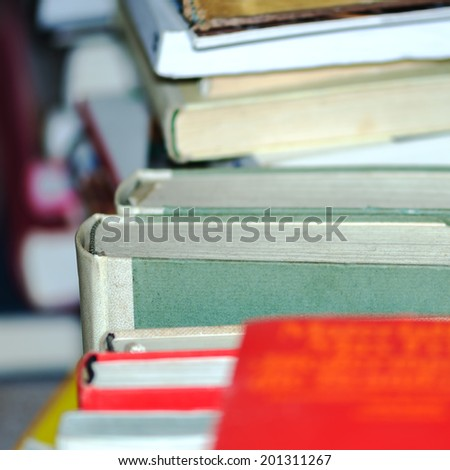 Detail of a pile of old stapled books. - stock photo