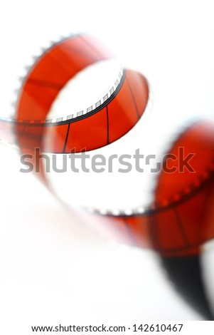 Detail of a red movie film isolated on white - stock photo