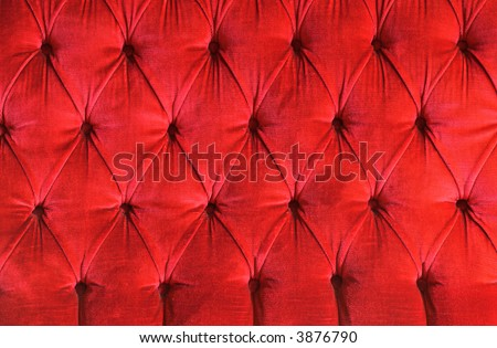 detail of a red velvet couch ideal as background - stock photo