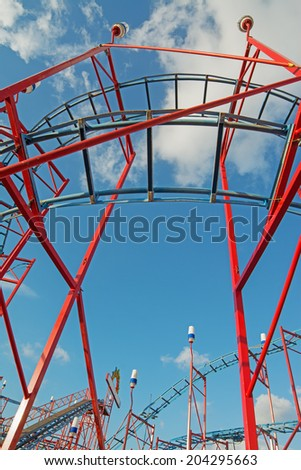 detail of a rollercoaster on a cloudy day - stock photo