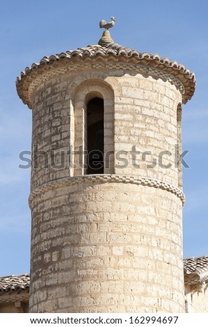 Detail of a round bell tower of the Church of Saint Martin located in Fromista, Palencia, Castile and Leon, Spain. It was in Romanesque style, it is located across the Way of Santiago - stock photo