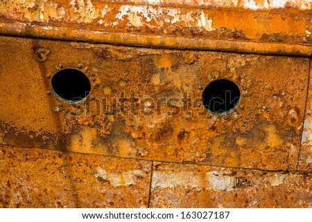 Detail of a rusty ship in the port - stock photo