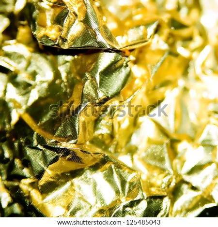 Detail of a shining golden foil. - stock photo