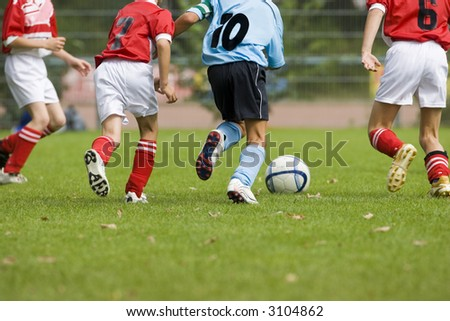Detail of a soccer game with four players in action - stock photo