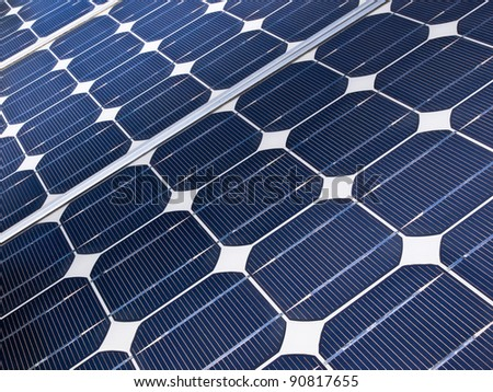 detail of a solar cell panel on a beautiful sunny day - stock photo