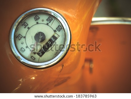 Detail Of A Speedometer On A Retro Vintage Moped Or Scooter - stock photo