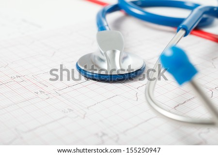 Detail of a stethoscope on a electrocardiogram - stock photo