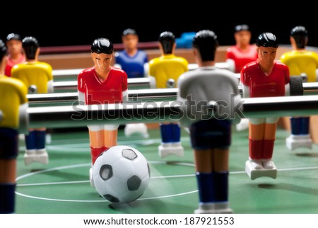 Detail of a table soccer game. - stock photo