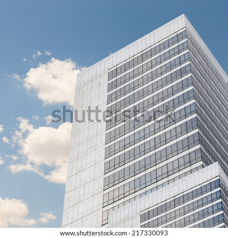 detail of a tall office skyscraper with mirror windows - stock photo