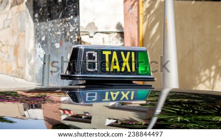 detail of a taxi cab in a Barcelona street  - stock photo