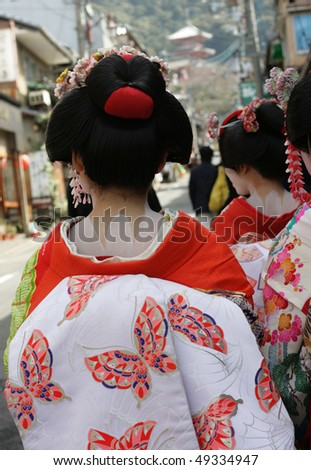 Detail of a the back of a Geisha girl, in a the streets of Kyoto.  Geisha girls are part of traditional Japanese culture that is still alive - stock photo
