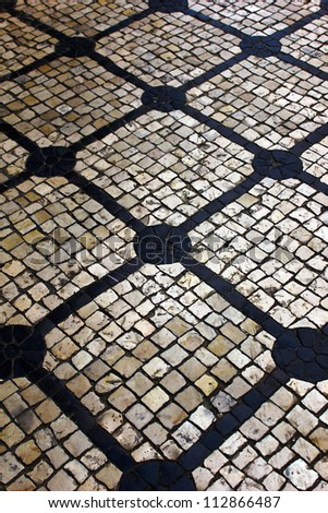 Detail of a typical portuguese stone pavement - stock photo