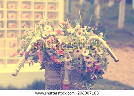 Detail of a Vintage Bicycle with Bouquet of flower, wedding decoration  (vintage color toned image) - stock photo