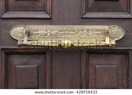 detail of a vintage door handle - stock photo