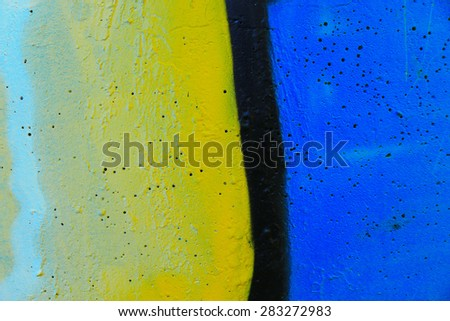 Detail of a weathered wall covered with graffiti - stock photo