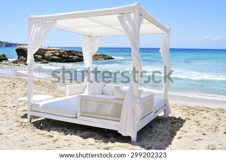 detail of a white bed in a beach club in a white sand beach in Ibiza, Spain - stock photo