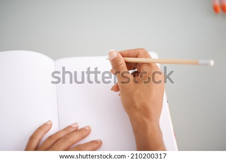 Detail of a woman writing some notes - stock photo