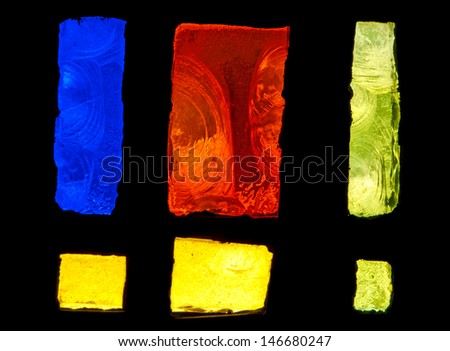 Detail of abstract design of stained glass window made of blue, red and yellow chipped slab glass  - stock photo