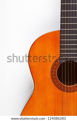 Detail of acoustic guitar on white - stock photo
