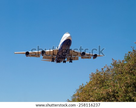 detail of airplane landing - front view - stock photo