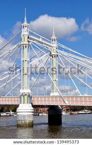 Detail of Albert Bridge over River Thames, London, England, UK - stock photo