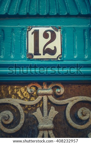 Detail Of An Apartment Number On A Rustic Blue Door In Paris - stock photo