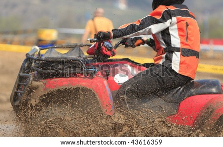 Detail of an ATV during the muddy race.The main focus is on the mud drops. - stock photo