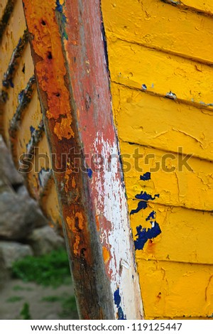 Detail of an old fishing boat rotting in the small harbour at Barna, near Galway, Ireland. - stock photo