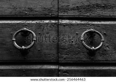 Detail of an old Italian door with iron knobs - stock photo