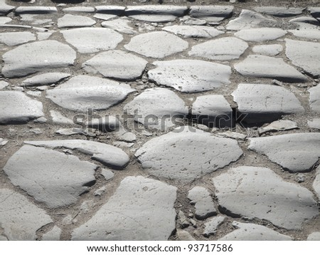Detail of ancient Appian Way (Appia Antica) original Roman age cobblestone, consisting of big slabs. Rome, Italy, Europe. Shallow DOF. - stock photo