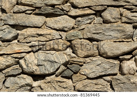 Detail of ancient stone wall in Ticino. - stock photo