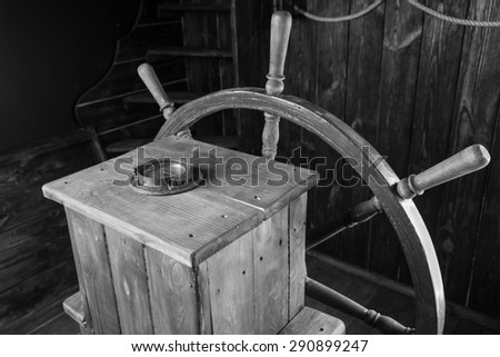 Detail of Antique Wooden Steering Helm with Wheel and Compass, Black and White Image of Historical Sailing Ship - stock photo