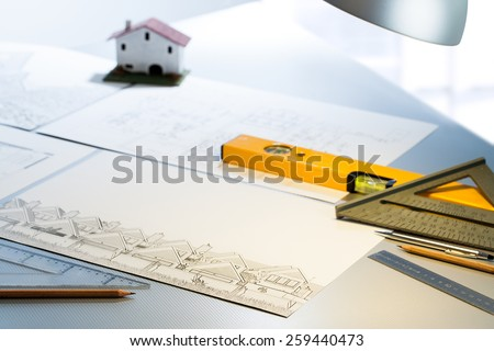 Detail of architect desk with technical drawings and measuring tools. - stock photo