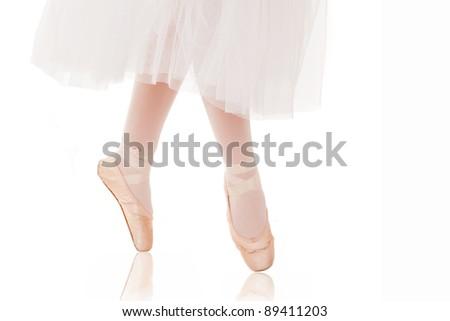 detail of ballet dancer's feet on white background - stock photo