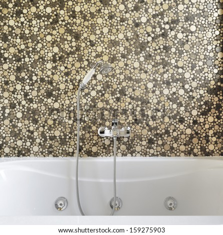detail of bathtub in a modern bathroom with mosaic tile - stock photo