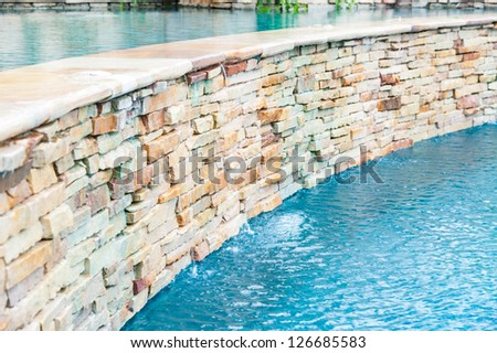 detail of beautiful swimming pool edge - stock photo