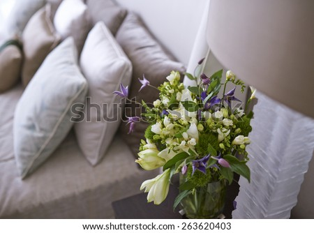 detail of bedroom with flowers - stock photo