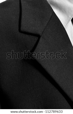 Detail of black business suit isolated over white background - stock photo