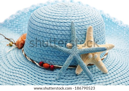Detail of blue ladies hat with couple of starfishes  - stock photo