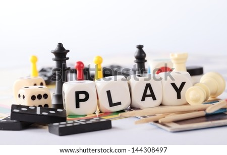 Detail of board games, pawns, chessmen, dominoes, mikado sticks and dice - stock photo