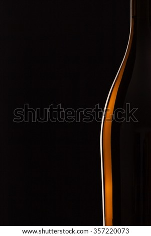 Detail of bottle with red wine on the black background - stock photo