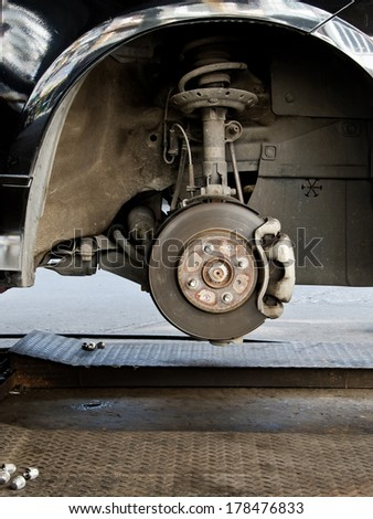Detail of brake disk and the wheel assembly . - stock photo