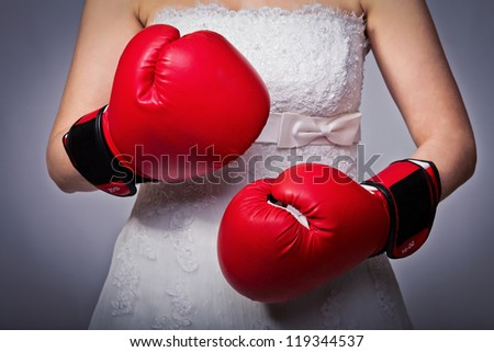 detail of bride wearing boxing gloves - stock photo