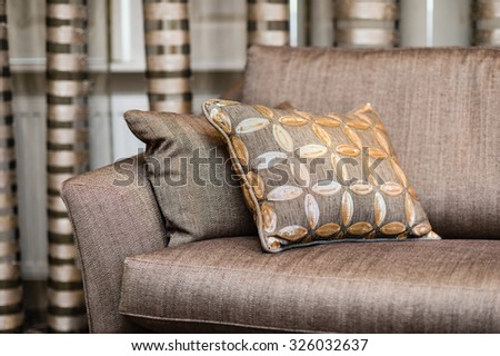 Detail of brown pillow on the brown sofa - stock photo