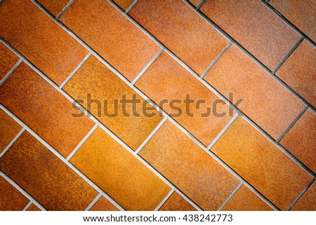 Detail of brown tile wall texture background - stock photo