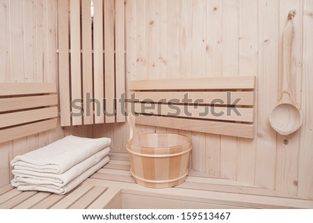 Detail of bucket and white towels in a sauna  - stock photo
