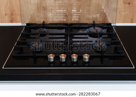 detail of burner gas stove in a kitchen - stock photo