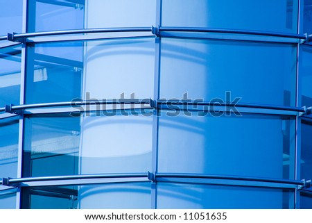 Detail of business building, diagonal, with blue tint. - stock photo